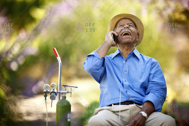 Senior man talking on his cellphone and laughing.