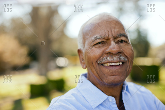 Portrait of senior man outside.