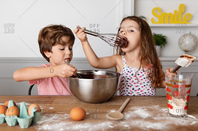Children making brownies together