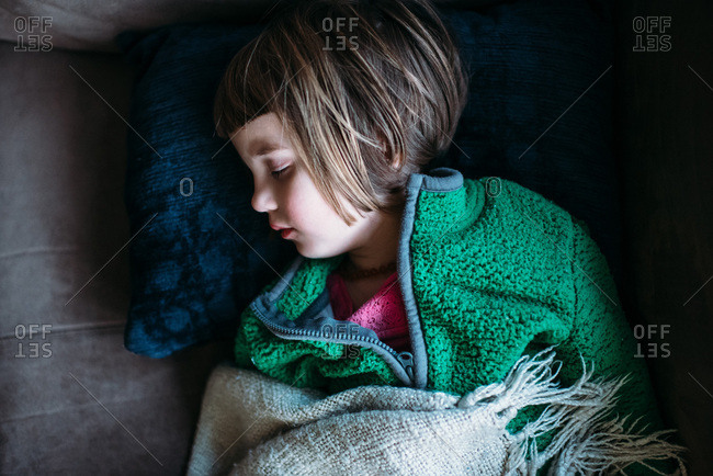 Toddler napping on a couch