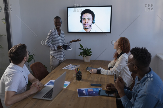Business people interacting through video call in conference at office