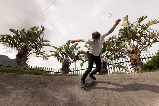 Low angle view of man skateboarding in skateboard park