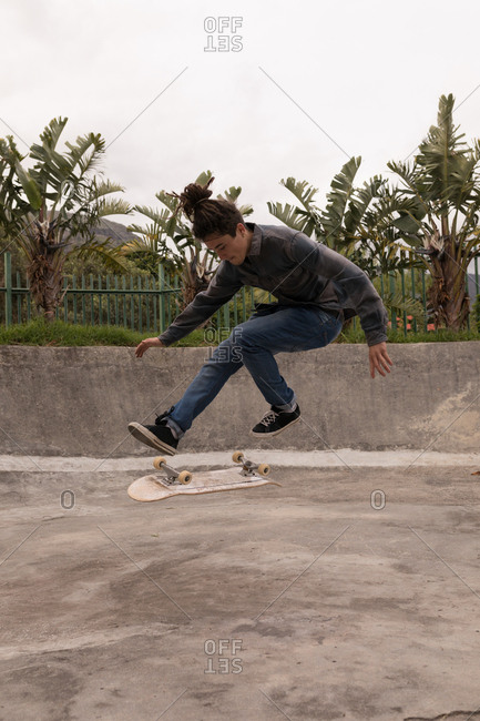 Young man skateboarding in skateboard park