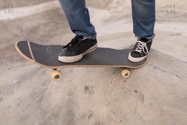 Close-up of man skateboarding at skateboard park