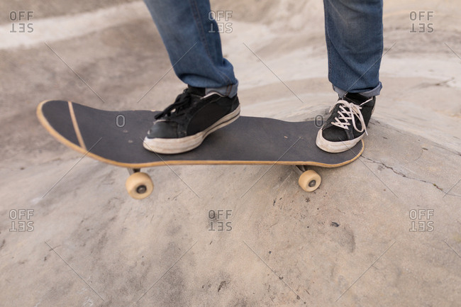 Close-up of man skateboarding at skateboard park