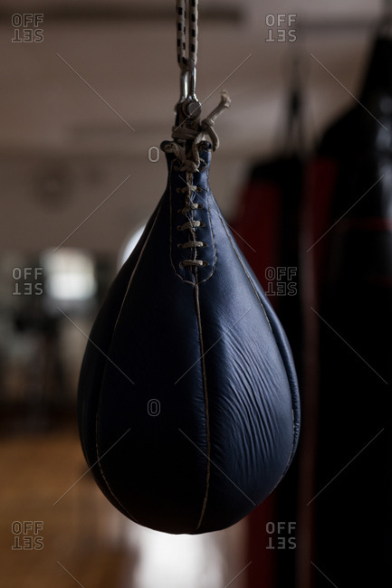Close-up of punching bag hanging in fitness studio