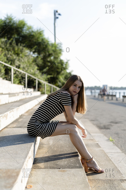 USA- New York- Brooklyn- portrait of young woman relaxing on stairs
