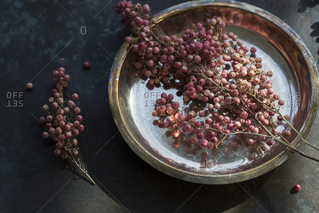 Pink peppercorns on silver tray