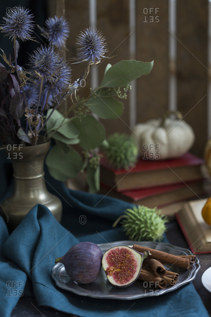 Still life with figs and cinnamon sticks