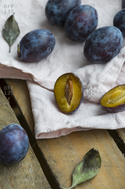 Whole and sliced plums