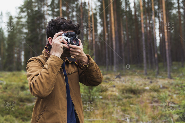 Finland- Lapland- man taking picture in rural landscape