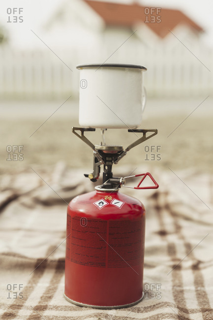 Cup of coffee boiling on a camping stove