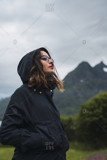 Portrait of a woman wearing hooded jacket- outdoors