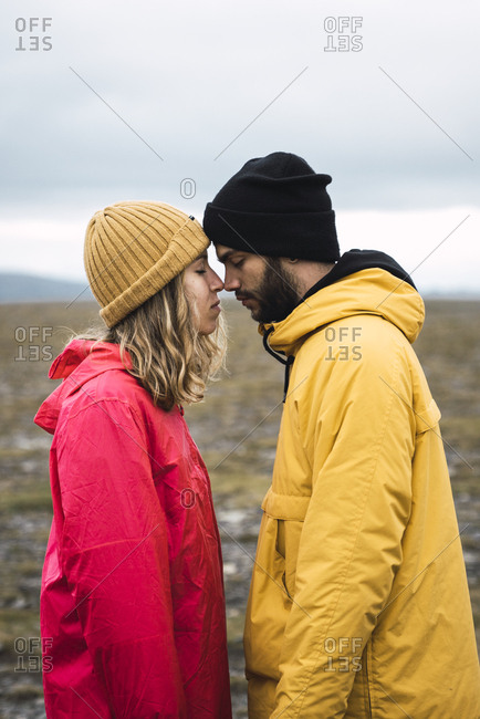 Young couple rubbing affectionately noses- Lapland- Norway