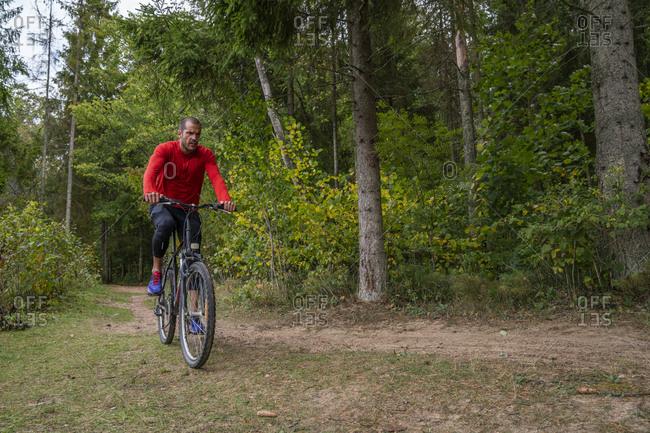 Athlete mountain biking in the woods