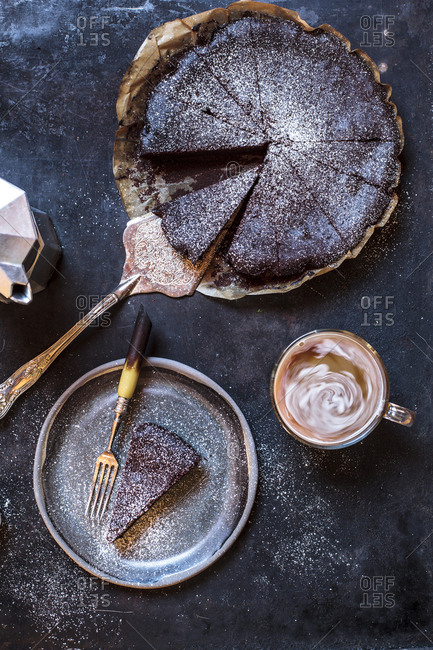 Swedish kladdkaka- dark chocolate cake- swedish brownie- with coffee- close-up