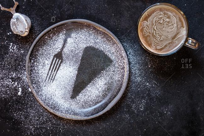 Swedish kladdkaka- dark chocolate cake- swedish brownie- with coffee- close-up