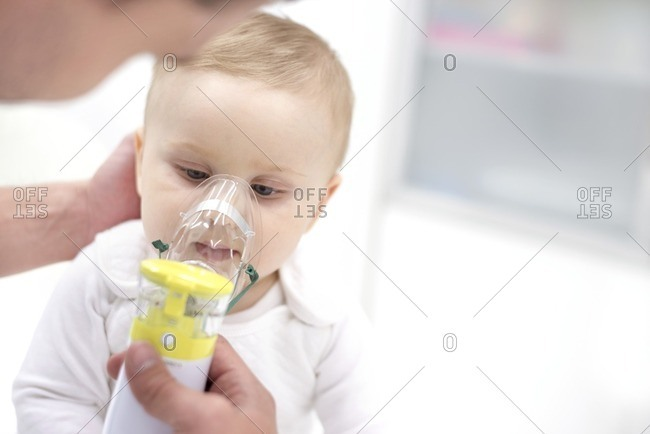 Baby boy using nebulizer.
