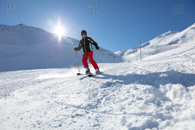 Man skiing down snow covered mountainside