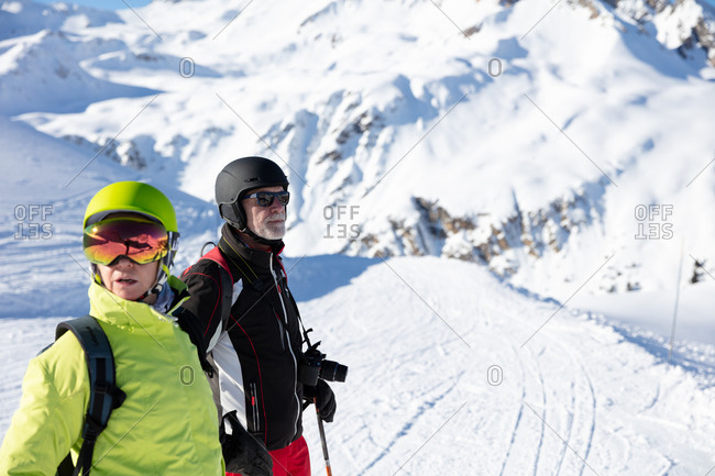 Couple standing on ski piste