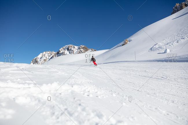 Skier sking down slope