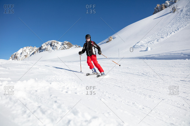 Ski holiday, Skier carving downhill