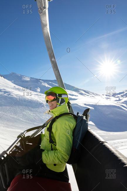 Happy senior woman in a ski lift
