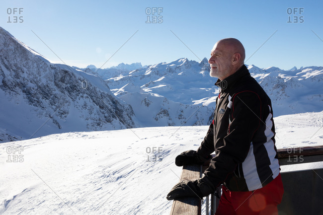 Portrait of senior man outdoors in mountains