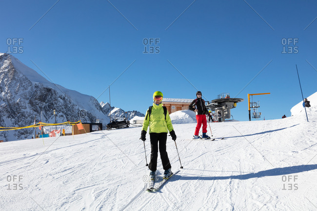 Skier couple skiing on snowy landscape during winter holiday