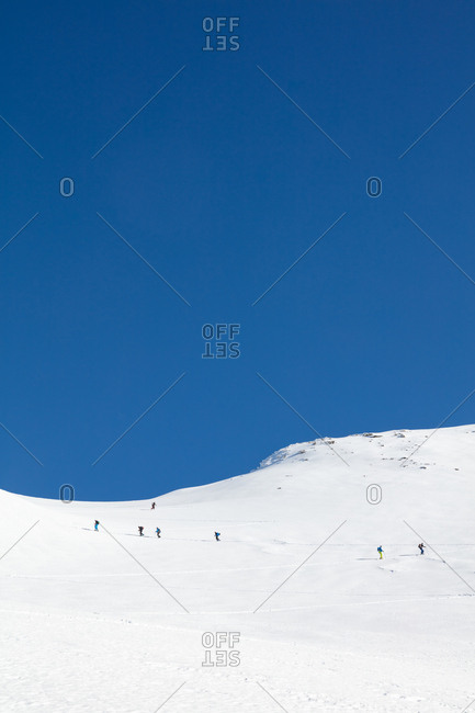 People walking through snow on the mountain