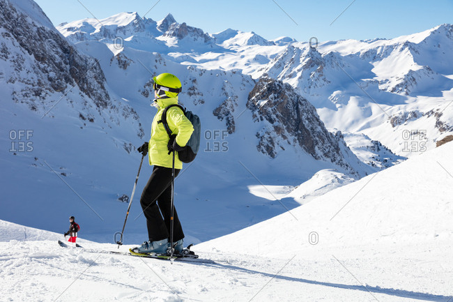 Woman enjoying mountain view on ski piste