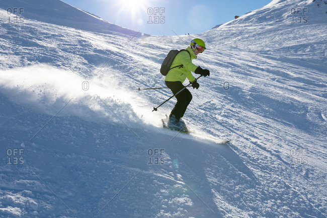 Ski holiday, Senior skier carving downhill