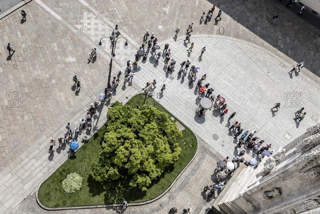 Milan, Italy - May 11, 2018: Overhead view from the duomo terraces of tourists visiting the Milan Cathedral