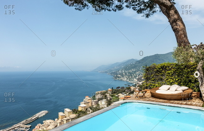 Swimming pool on coastal bluff overlooking seaside village