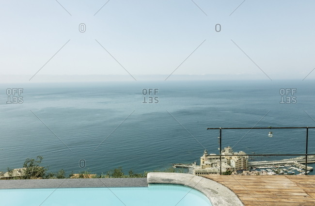 Swimming pool on coastal bluff overlooking Mediterranean Sea