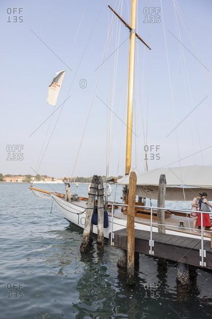 Venice, Italy - September 12, 2018: Eilean sailing boat docked at San Giorgio Island for Homo Faber event
