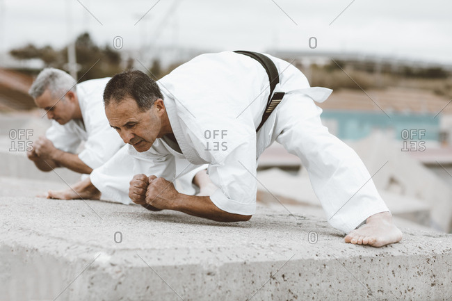 Karate fighters practicing martial art stretches