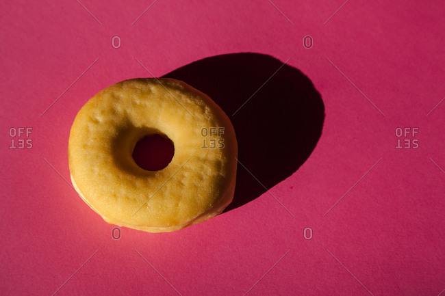 One classic donuts without cover on pink background