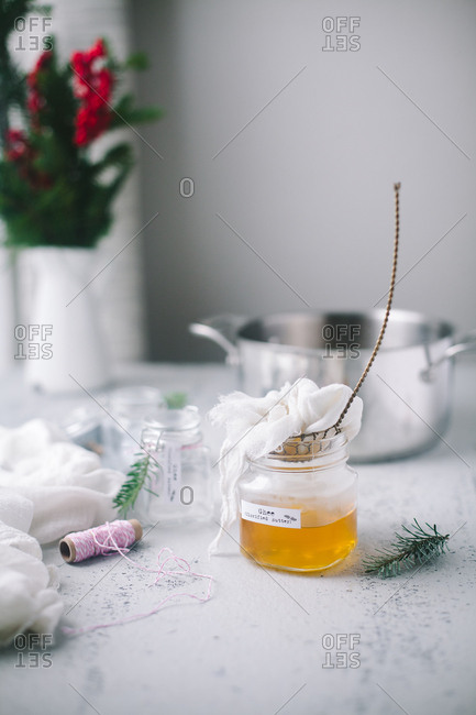 Glass jar filled with freshly made ghee