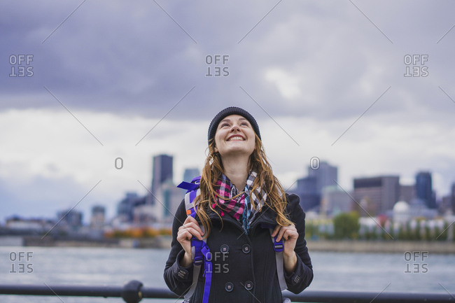 Solo woman traveller exploring with city skyline, Montreal, Quebec, Canada