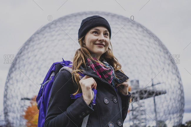 Solo woman traveller exploring landmark during autumn, Montreal, Quebec, Canada