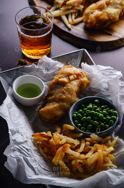 Fish and chips with a glass of beer. British traditional fast food