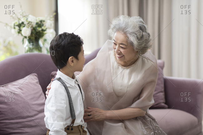 Happy Chinese grandmother chatting with grandson