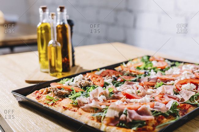 Close-up of pizza in tray on table at pizzeria