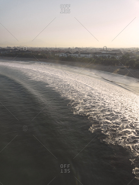 Aerial scenic view of sea against sky during sunset