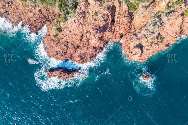 Aerial view of rocky coastline during sunny day
