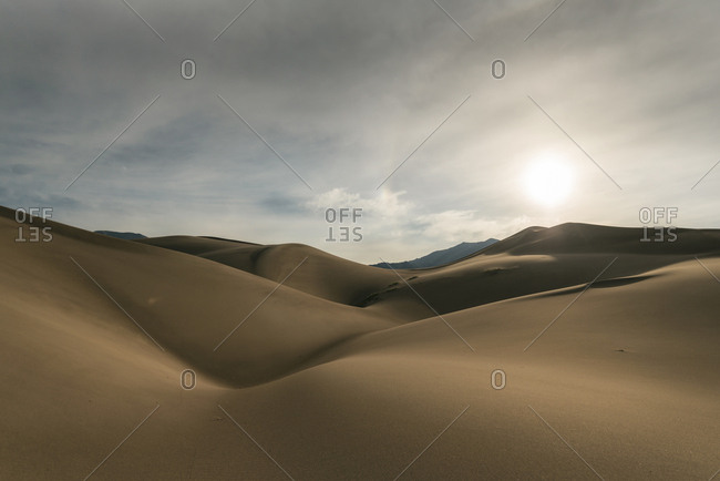 Tranquil view of desert against sky at Great Sand Dunes National Park during sunset