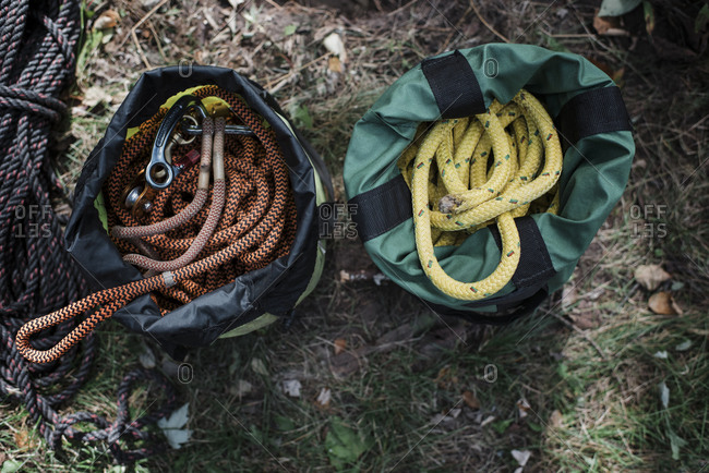High angle view of climbing ropes in bags on field