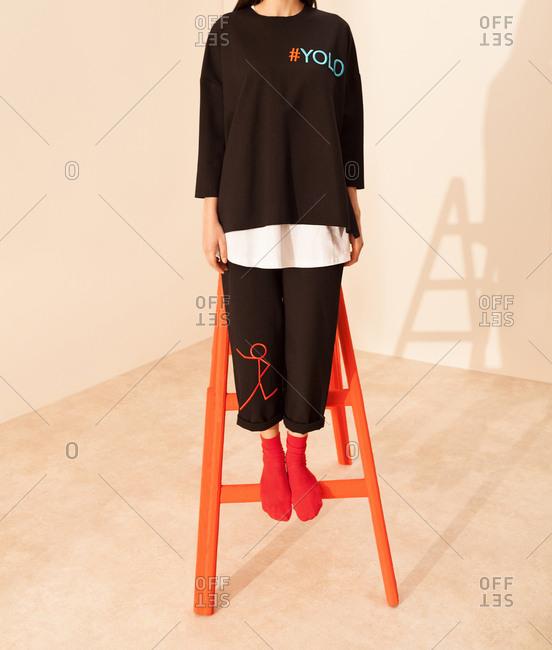 Model wearing black tracksuit