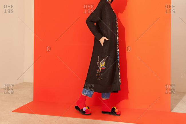 model wearing long black coat